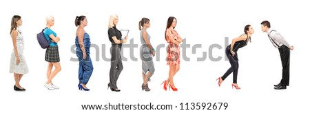 Women waiting in line to kiss a guy isolated on white background - stock photo