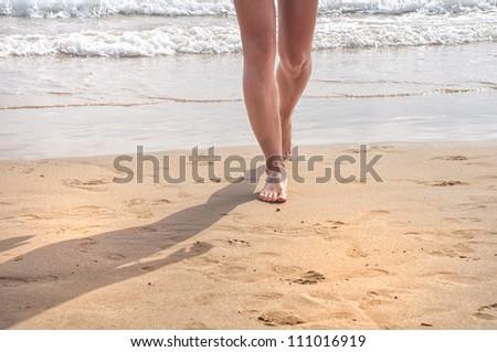 Women walking on the beach - stock photo