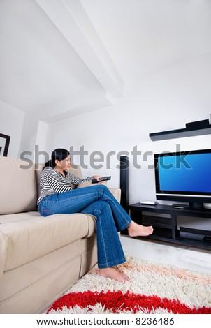 Women watching television - stock photo