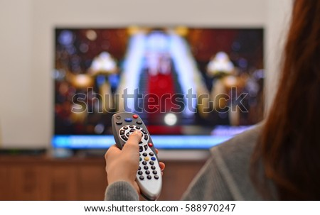 stock-photo-women-watching-tv-and-use-re...970247.jpg
