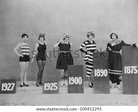 Women wearing fashions of different eras - stock photo
