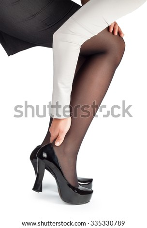 Women wearing high heels black shoes massaging tired legs isolated on white background