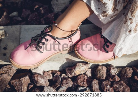 Women wearing pink boots, vintage style. - stock photo