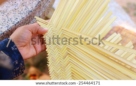 Women weave pattern hand bamboo, Bamboo weaving. - stock photo