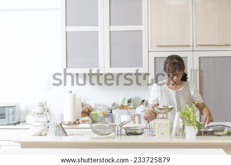 Women who seriously cooking in the kitchen - stock photo