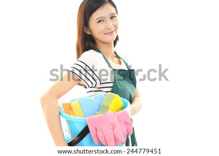Women with a cleaning tool - stock photo