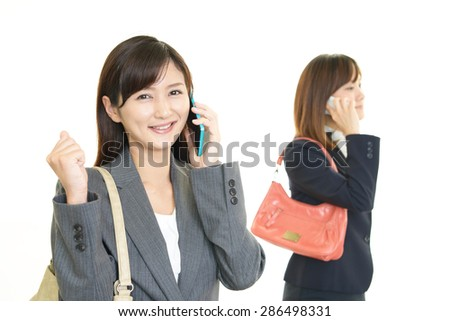 Women with a smart phone - stock photo