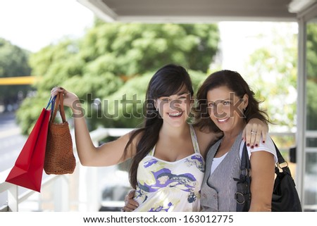 women with bags and looking at camera - stock photo