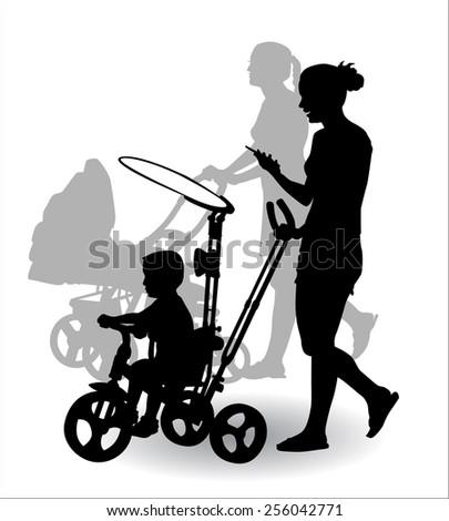 Women with children ride in the stroller children for a walk - stock photo