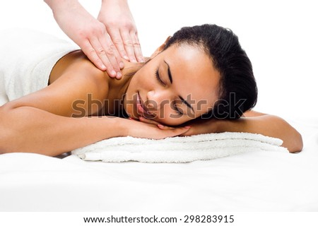 women with closed eyes receiving massage in a spa center - stock photo