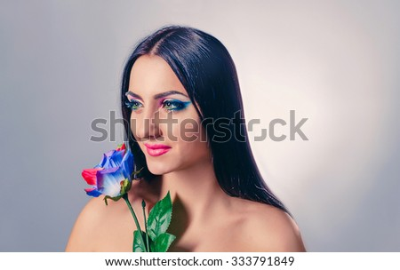 Women with colorful flower and copy space - stock photo