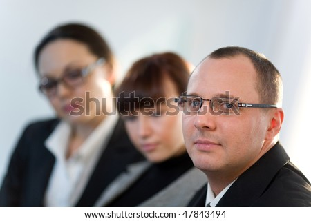 Women with girl and men in glasses - stock photo