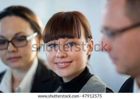 Women with nice girl and men - stock photo