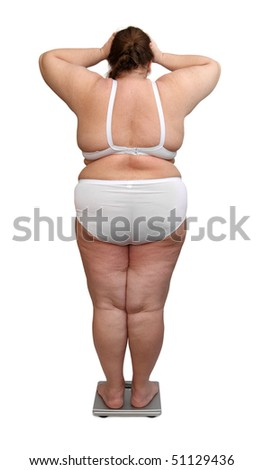 women with overweight in underwear from behind on scales - stock photo