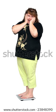 women with overweight standing on bathroom scales - stock photo