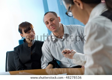 Women with paper and men with girl in black jacket - stock photo