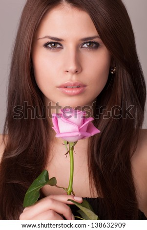 Women with pink rose
