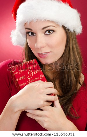 Women with red gift for christmas on red background - stock photo