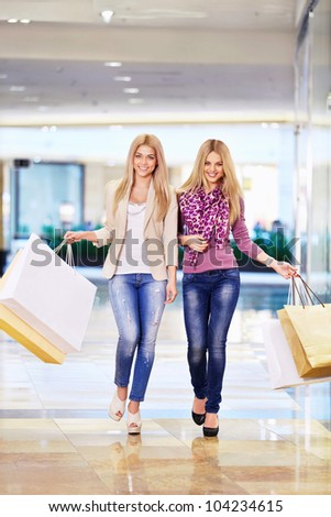 Women with shopping bags in store - stock photo