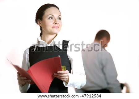 Women with smile with red folder - stock photo