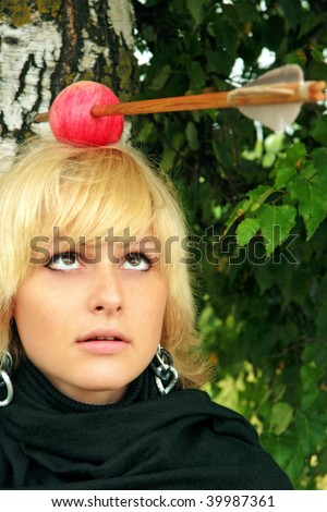 women with the arrowed apple on the head - stock photo