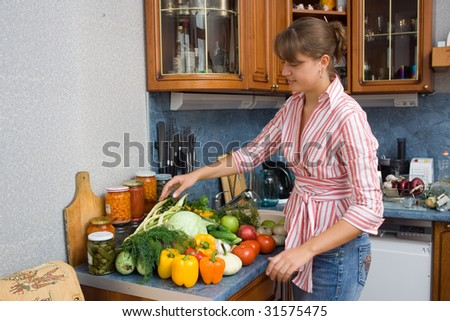 Women with vegetables in the kitchen