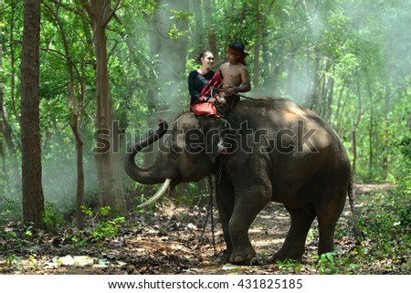 Women with young elephant