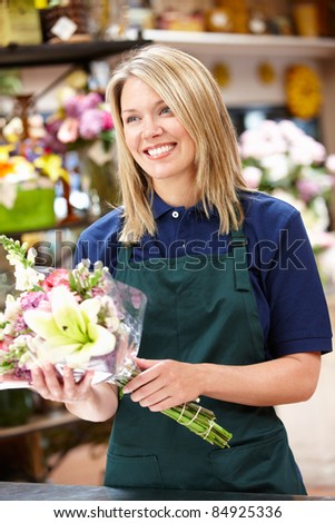 Women worker holding flowers in florist - stock photo