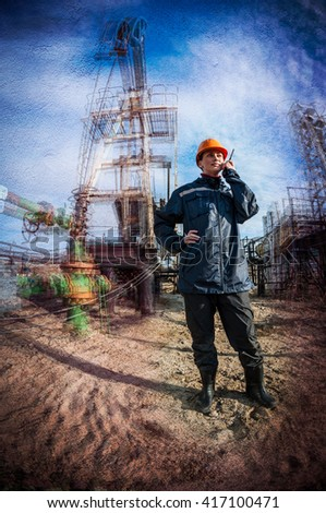 Women worker in the oil field talking on the radio wearing orange helmet and blue work clothes. Industrial site background. Textured concrete grunge, blurred motion.