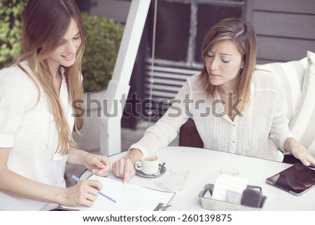 Women working in a cafe - stock photo