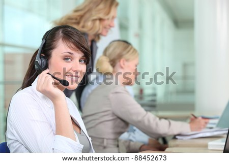 Women working in a call center - stock photo