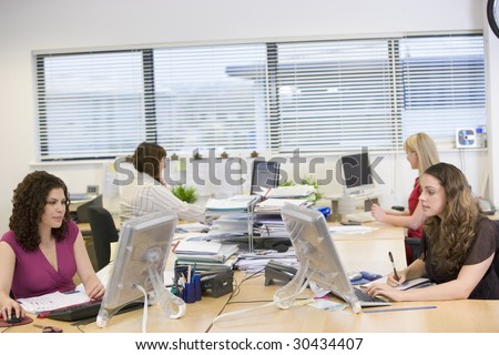 Women working in an office - stock photo