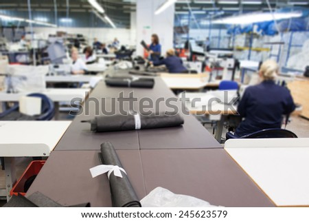 women working in textile factory - stock photo