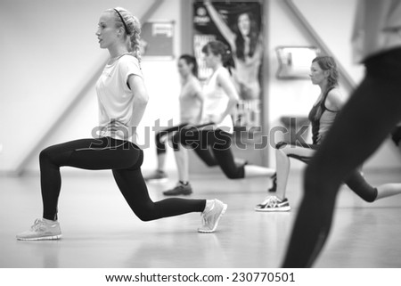 Women working out at the gym; leg training exercises  - stock photo