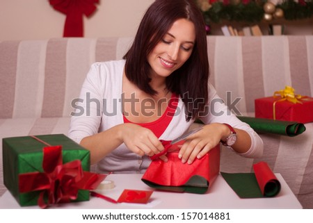 Women Wrapping Christmas gifts - stock photo