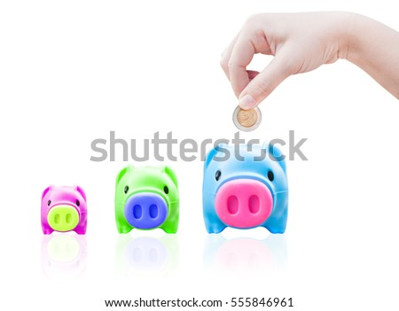 women young hand putting money coin into saving pig, finance theme,Isolated on white background