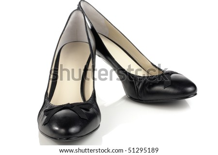 Womens black shoes with a heel on a white background
