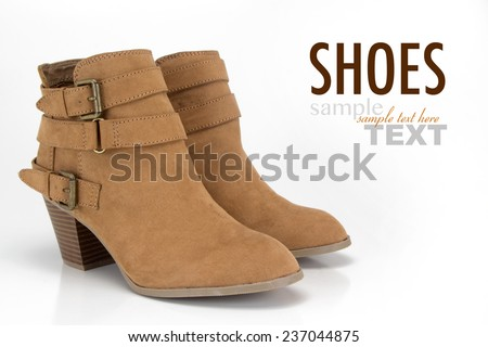 Womens brown suede fashion boots isolated with sample text. Shot in studio on a white background. - stock photo