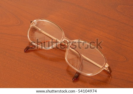 Womens glasses on a table - stock photo