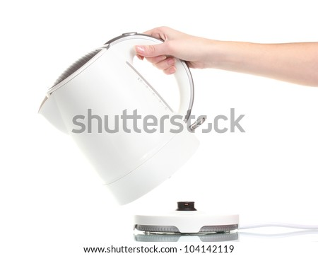Womens hand and white electric kettle isolated on white - stock photo