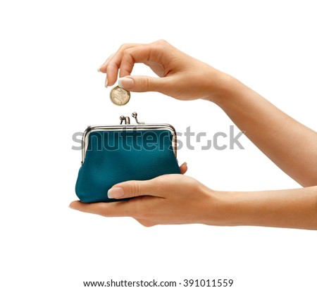 Womens hand throwing a coin one euro in the purse on white background. Business concept - stock photo