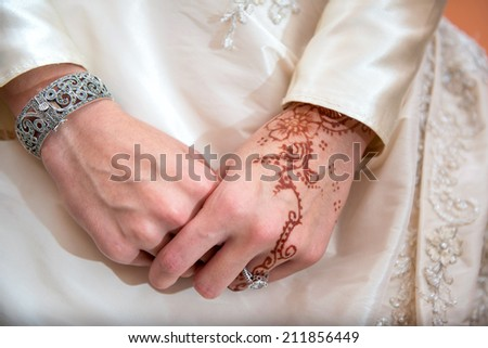 Womens hands decorated with henna