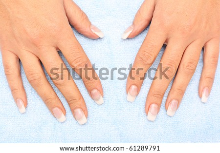 Womens hands with french manicure