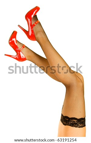 Womens legs and red shoes isolated on white background