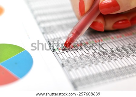 wonan checking the statistics of purchases and sales - stock photo
