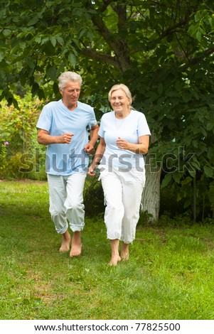 wonderful aged couple smiling and playing  at nature