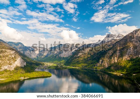 Wonderful and picturesque view on mountains and lake is pictured from the viewpoint located high above the Hallstatt, Austria