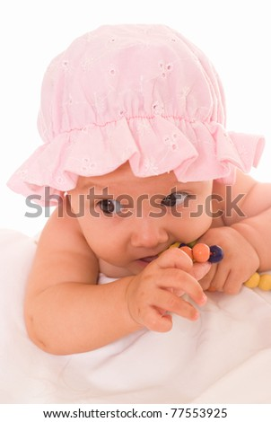 wonderful baby with toys in a white