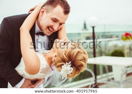 wonderful beautiful couple hugging outdoors - stock photo