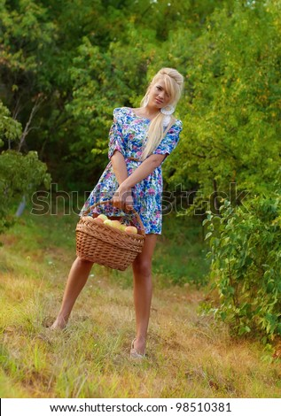 Wonderful blond women in nature holding apples - stock photo
